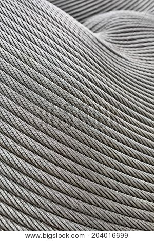 Fragment of the steel wicker ropes which create the abstract figure. Closeup vertical photo.