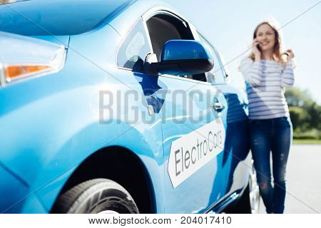 Electro automobile. Selective focus of a new modern electro car being parked on the street