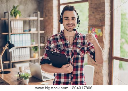 Successful Manager Operator Of A Telemarketing Standing In Modern Workstation, With Black Clipboard