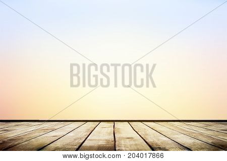 Empty wooden table with blurred autumn natural background with bokeh