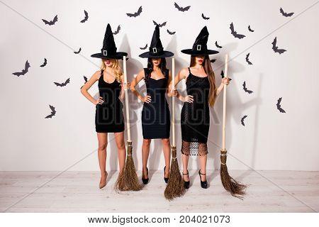 Boo! Full Length Of Group Of Three Terrifyng Mysterious Dark Mistress Vampire Monsters In Elegant Co
