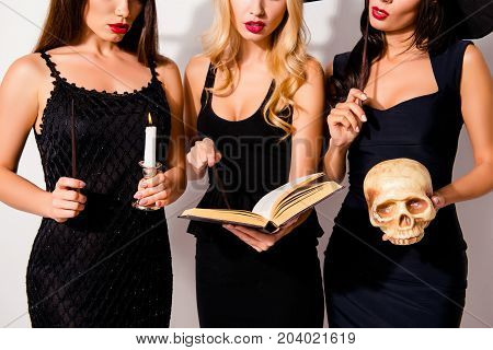 Cropped Shot Of Three Hot Sorceress Supersition Spiritualists, Practising Occultism, With Skeleton H