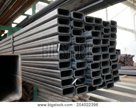 Rust steel beams iron bar on outdoor construction site.