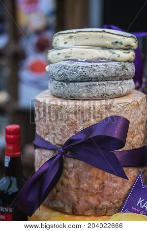 Utrecht Netherlands December 9 2016: Stilton and a stack of blue cheese displayed on the food festival.