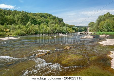 River Ardeche along the old village Vogue which village is recognized as historical heritage and is considered one of ten charming villages of France
