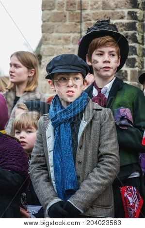 Deventer Netherlands - December 18 2016: Children perform in a musical during the Dickens Festival in Deventer in The Netherlands