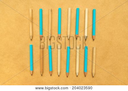 Pencils aligned in flat lay top view - abstract pattern background for ideas creativity writing and education