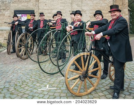 Deventer Netherlands - December 18 2016: demonstration of penny-farthing riders during the Dickens Festival in Deventer in The Netherlands