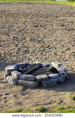 Rock camp fire pit on sandy beach with copy space