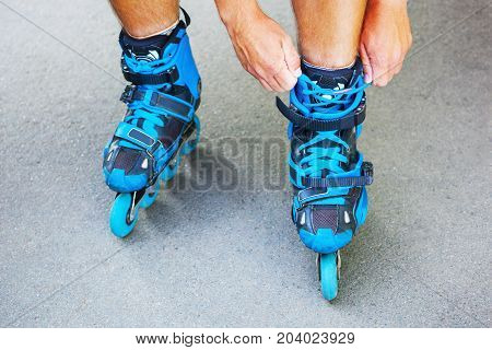 Closeup Of Roller Tying Laces On Inline Roller Skates.