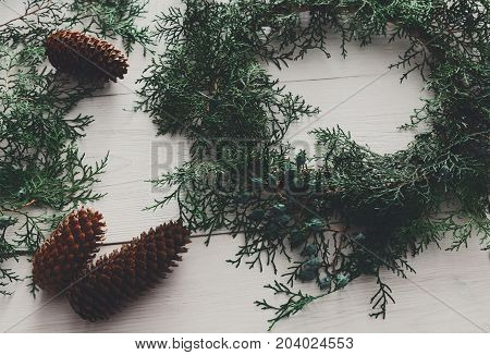 Christmas handmade diy wreath and garland. Creative craft hobby. Home leisure, tools for holiday decorations on white wooden table