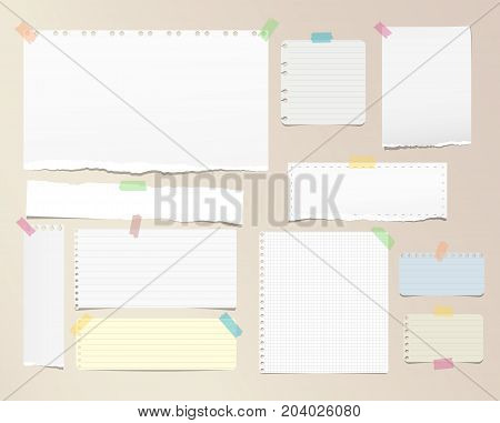 Torn ruled, squared note, notebook, copybook paper strips, sheets stuck with sticky tape on brown background