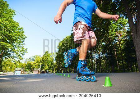 Inline Roller Skater On A Slalom Course