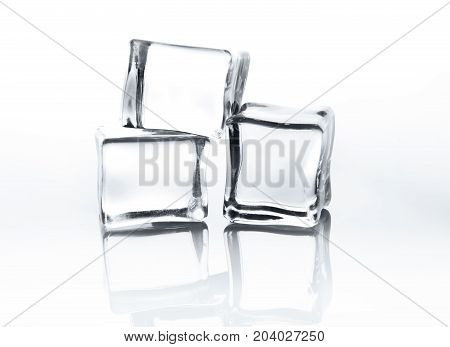 Transparent ice cubes with reflection isolated on white background. Closeup of cold crystal blocks set cutout