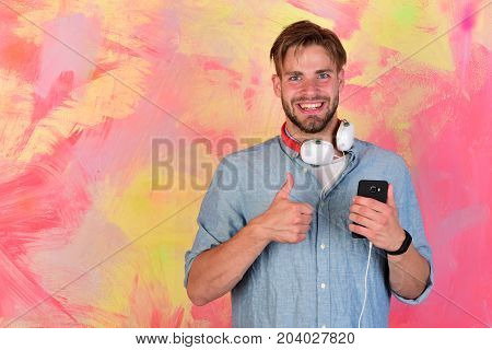 Musical Lifestyle. American Handsome Bearded Guy With Headphones.