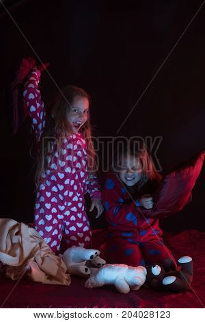 Children Have Pajama Party With Pillows And Teddy Bears