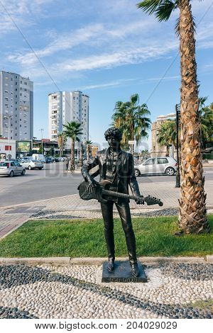 ALBANIA DURRES - September 22 2015: Sculpture Bob Dylan on the embankment near the palm tree