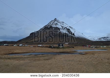 Village of Arnastapi in Iceland at the base of Mount Stapafell.