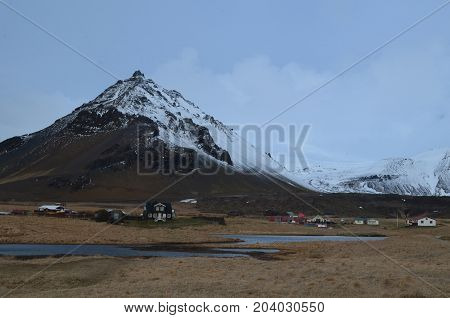 Beautiful Mt Stapafell in Iceland with a village at the base.