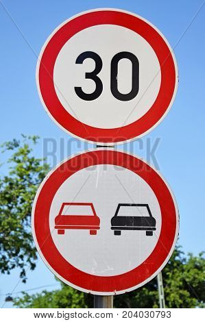 Do not overtaking and speed limit signs