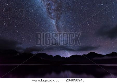 Milky Way landscape. Clearly Milky way above Lake Segara Anak inside crater of Rinjani mountain on night sky. Lombok island Indonesia.