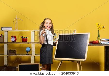 Kid And School Supplies On Yellow Background