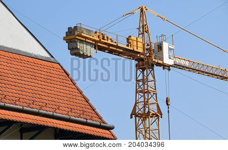 Tower crane next to a building at the construction site