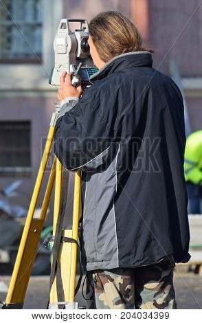 Land surveyor works at the road construction