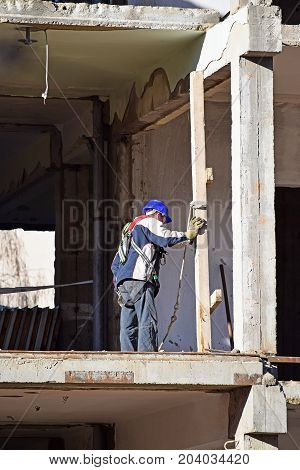Construction worker is working on a building