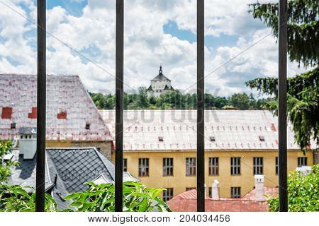 New castle behind a metal fence Banska Stiavnica Slovak republic Unesco. Architectural theme. Travel destination. Cultural heritage.