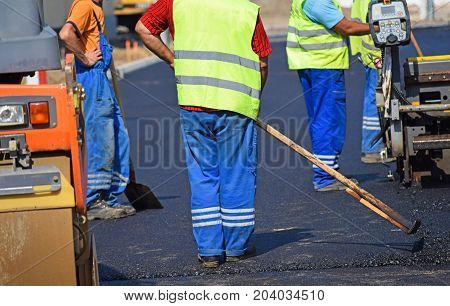 Construction workers at the road construction in the city