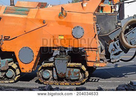 Road scraper vehicle at the road construction