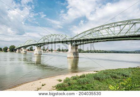 Maria Valeria bridge joins Esztergom in Hungary and Sturovo in Slovak republic across the Danube river. Transportation theme. Architectural scene.