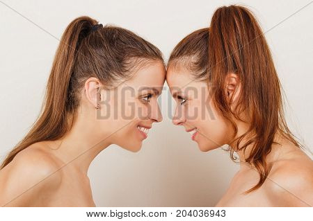 Two Smiling Sisters Twin, Light Background