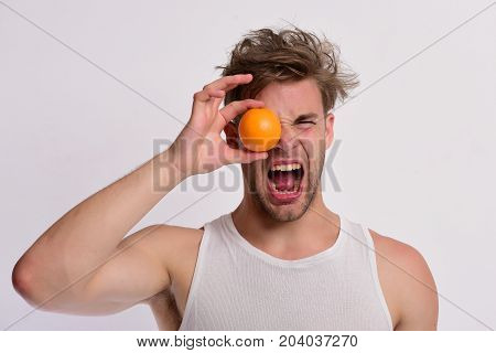 Nutrition And Healthy Lifestyle Concept. Man With Orange Covering Eye