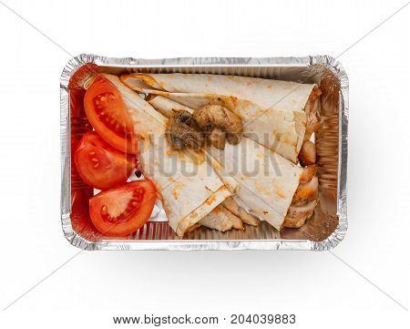Healthy lunch in foil container. Healthy food take away and delivery. Cuted tomatoes, fried mushrooms and pancakes with chicken in box on white background, closeup, isolated