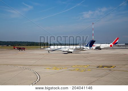 Basel, Switzerland - July 18, 2017: Several airplanes parked at the airport