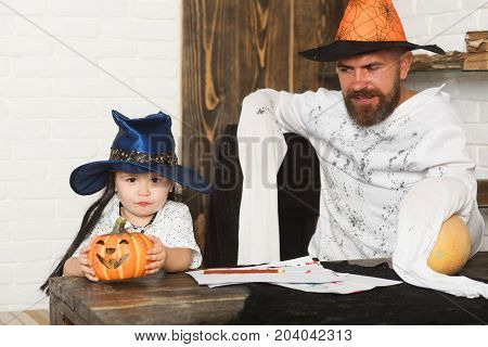 Man And Boy On Wooden And White Brick Background