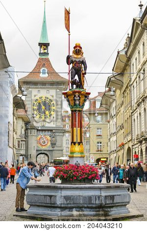 Bern, Switzerland -  October 11, 2014 : People On The Shopping Alley With The Famous Clocktower Of B
