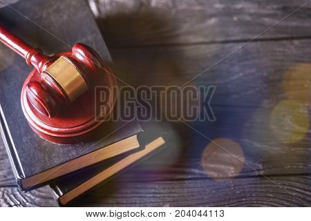 Wooden books gavel background close-up paper business