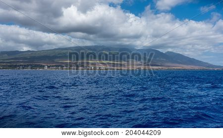 A view of hill on West Maui in Hawaii. Shot taken from the water.