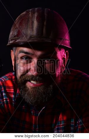 Worker With Brutal Image Wears Dirty Red Helmet And Shirt