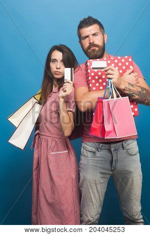 Guy With Beard And Pretty Lady With Serious Faces