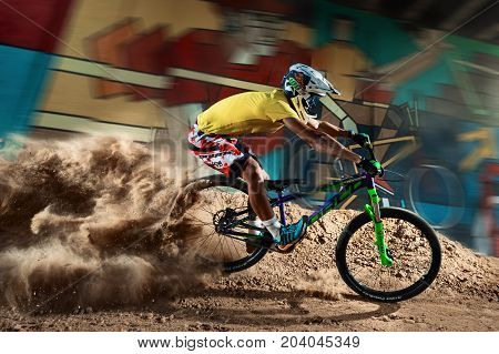 Moscow, Russia - August 8, 2017: Biker Riding With Aggressive Turns. Mountain Bike Cyclist Riding Pu
