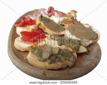 Typical rustic tuscan appetizer with crostini prosciutto brawn salami cheese on a wooden tray . Italian starter isolated on white background