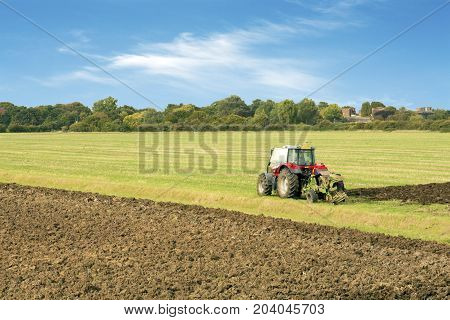 tractor ploughing a field tilbury essex uk