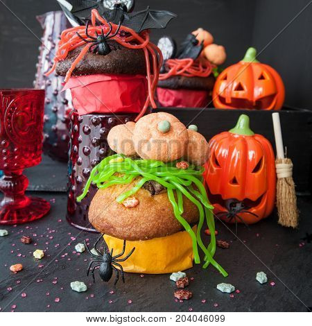 Colorful treats and cakes for a happy Halloween
