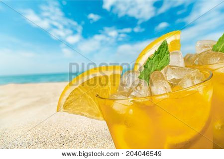Glasses lemon cocktails color background party relaxation