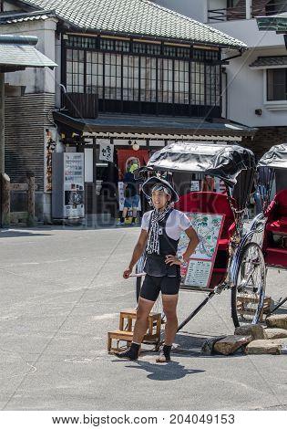 Jinrikisha (rickshaw) Waiting For Passengers At Miyajima (itsukushima ) Island. Japan. Jinrikisha Is