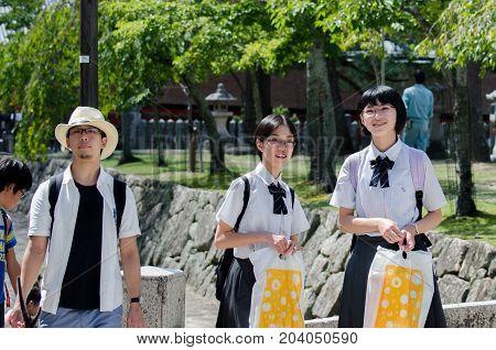 Japanese Young Schoolgirls And Tourists At Miyajima (itsukushima ) Island. Japan